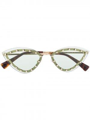 Солнцезащитные очки в овальной оправе с заклепками Valentino Eyewear. Цвет: золотистый