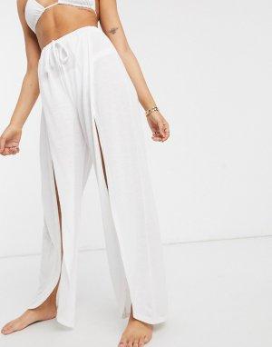 Белые трикотажные пляжные брюки с разрезом спереди -Мульти ASOS DESIGN