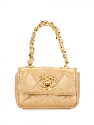 Стеганая мини-сумка 1990-го года с логотипом CC Chanel Pre-Owned. Цвет: золотистый