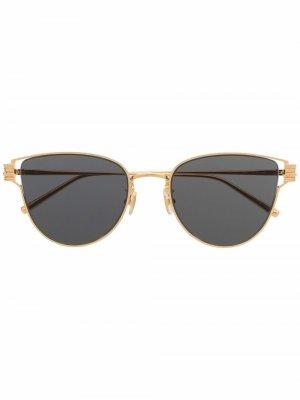 Солнцезащитные очки в овальной оправе Boucheron. Цвет: золотистый
