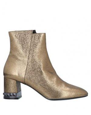 Полусапоги и высокие ботинки BRUNO PREMI. Цвет: золотистый