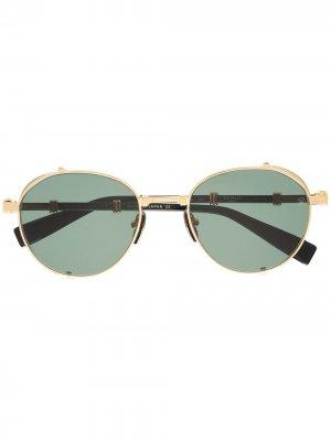 Солнцезащитные очки в круглой оправе Balmain. Цвет: золотистый