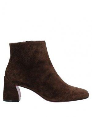 Полусапоги и высокие ботинки CHRISTIAN LOUBOUTIN. Цвет: темно-коричневый