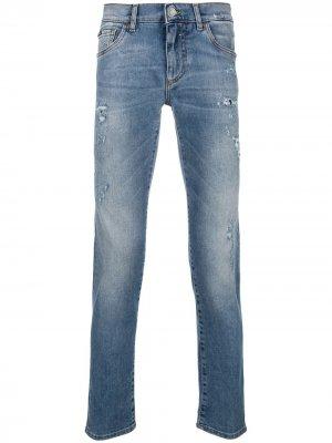 Джинсы с прорванными деталями Dolce & Gabbana. Цвет: синий
