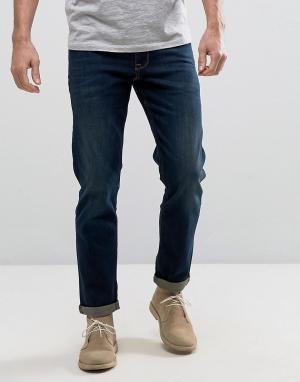 Темные узкие джинсы стретч ASOS DESIGN. Цвет: синий