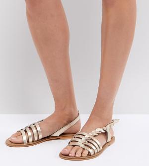 Кожаные сандалии с Т-образными ремешками ASOS FLATTERED DESIGN. Цвет: золотой