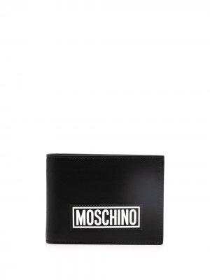 Бумажник с логотипом Moschino. Цвет: черный