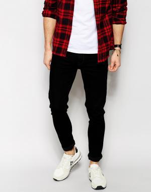 Черные супероблегающие джинсы ASOS DESIGN. Цвет: черный